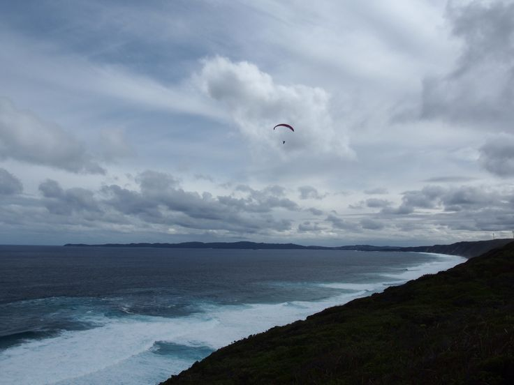 Hang glider over Albany's Torndirrup National Park and Great Southern Ocean,  Western Australia.