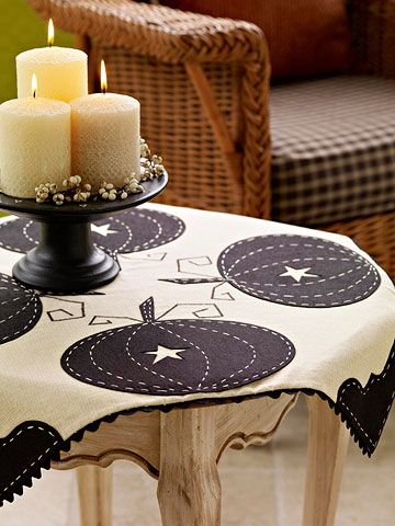 Felt Pumpkin Tablecloth (BHG). Our main table is small and square, so this should work perfectly. I like the idea of offsetting the cloth on the table (i.e. laying it out in a diamond shape atop a square)