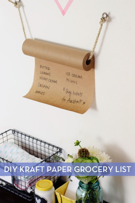 I tend to make grocery lists on scrap pieces of paper, but unfortunately, I always forget to bring them to the store. This hanging kraft paper grocery list by At...
