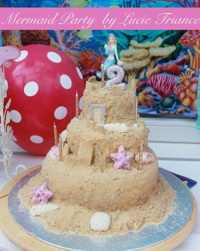 "CHEATS EASY PEASY sandcastle, make a 10"" cake  buy 2 cake dummies made out of polystyrene, cover all 3 in vanilla frosting, cover in the sand mixture (broken biscuits and golden sugar) emmm yummmmy!!!!!  decorate with white and raspberry chocolate in shell moulds by wilton, any left over biscuits break in oblongs and use as the turrets keeping in place with frosting, gold metallic candles.  this cake was for my daughter Darcies 2nd birthday and was a very special day, see more photos on my…"