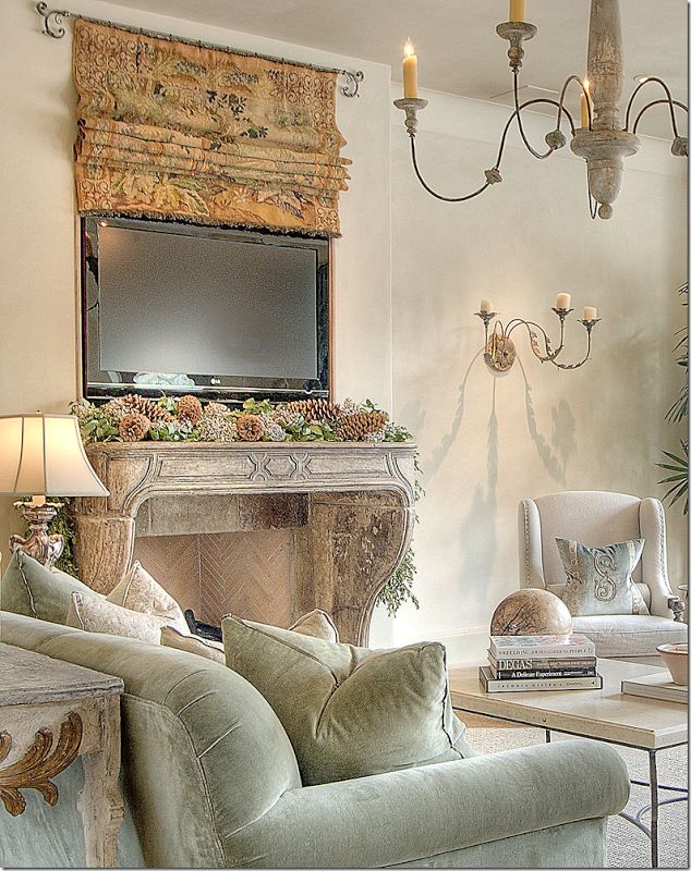 Clever TV set up behind a tapestry! Designed by Kara Childress of Houston. From the cotedetexas blog.