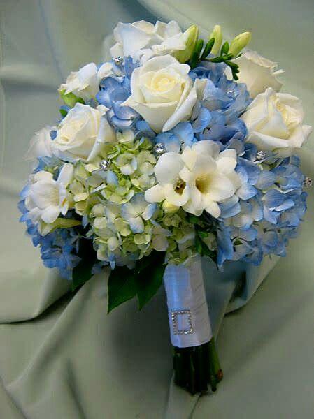Blue hydrangea white freesia roses wedding bouquet
