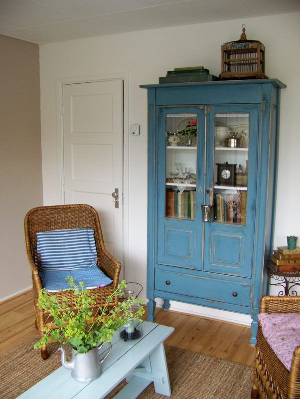 painted bookcase, painted bench as coffee table, wildflowers, antiques
