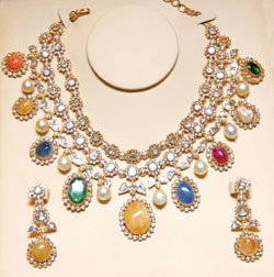 Gold and Diamond jewellery designs: tbz navaratna diamond necklace