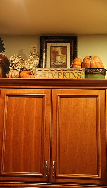 Top 25 ideas about above kitchen cabinets on pinterest for Above cupboard decoration