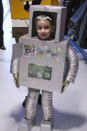 Make a robot costume out of 2 boxes, dryer venty tube-things, silver spray paint, duct tape, baby wipe boxes/robot shoes and various robot-like stick on attachments.  Trust me, it will be awesome.  I mean- look at my kid!