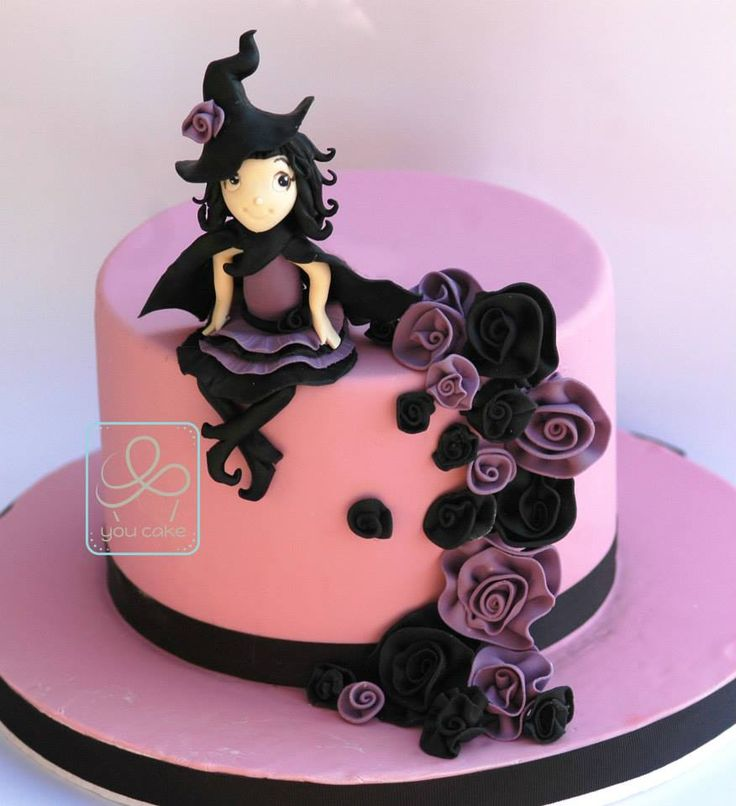 Halloween cake. I wonder if I could pull off an actual sculpture? This is cute, and I love the colors!