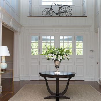 Chic traditional foyer entrance design with sisal rug, espresso entry foyer table, brass antique mirror console table, baby blue lamps and bicycle art. Description from decorpad.com. I searched for this on bing.com/images