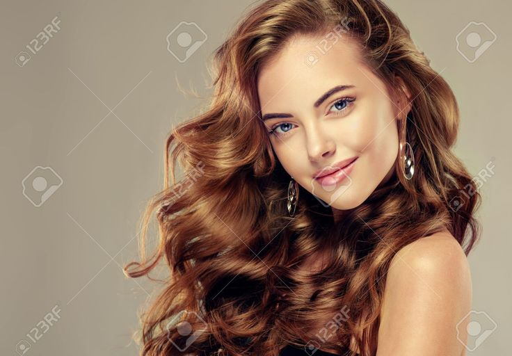 Beautiful Girl With Long Wavy Hair . Brunette Model With Curly ...