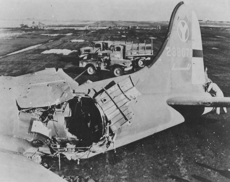 Italy - Blasted wide open in the waist section by enemy flak, this 15th AAF Boeing  B-17 Flying Fortress limped home 600 miles and with skillful piloting crash landed without additional injury to the crew.