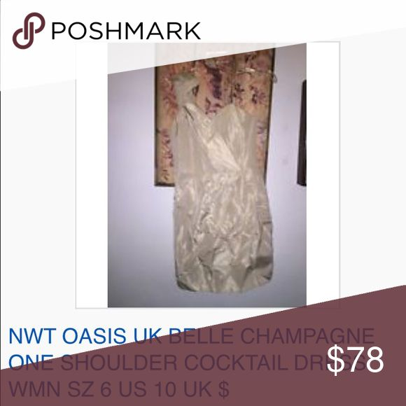 NWT OASIS UK BELLE CHAMPAGNE  COCKTAIL DRESS 6 NWT OASIS UK BELLE CHAMPAGNE ONE SHOULDER COCKTAIL DRESS WMN SZ 6 US 10 UK $250 All reasonable offers accepted and encouraged! Combined shipping discount with purchase of additional items. All items come from a CLEAN, SMOKE-FREE home Oasis Dresses Mini