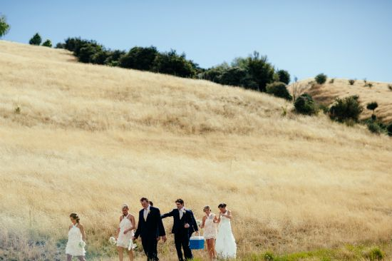 This is such a good idea picture, the wedding party taking a walk to the photos spot