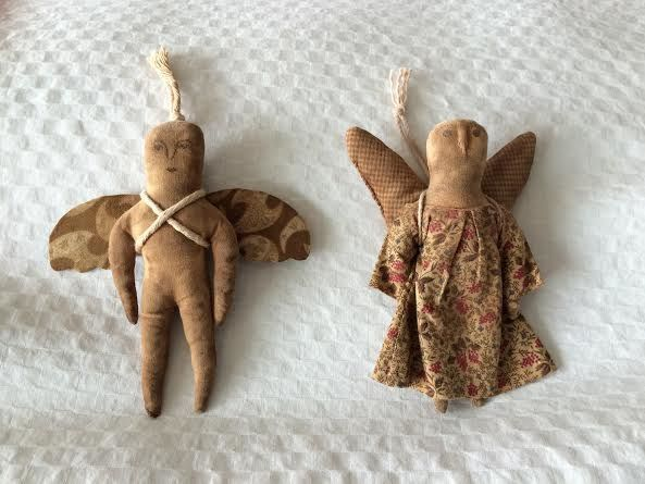 pair of folk art angel by norma schneeman