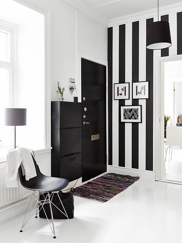 Via Stadshem | Black and White Hallway | Ikea | Eames Chair