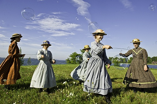 """Ladies at play in period costume at """"upper Canada village"""""""