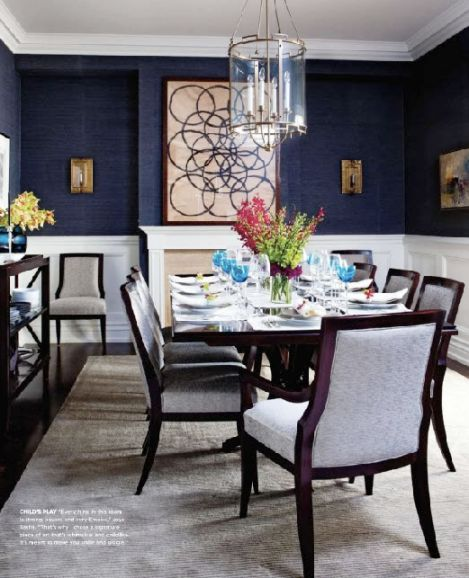love the deep blue walls for dining the white wainscoting softens the