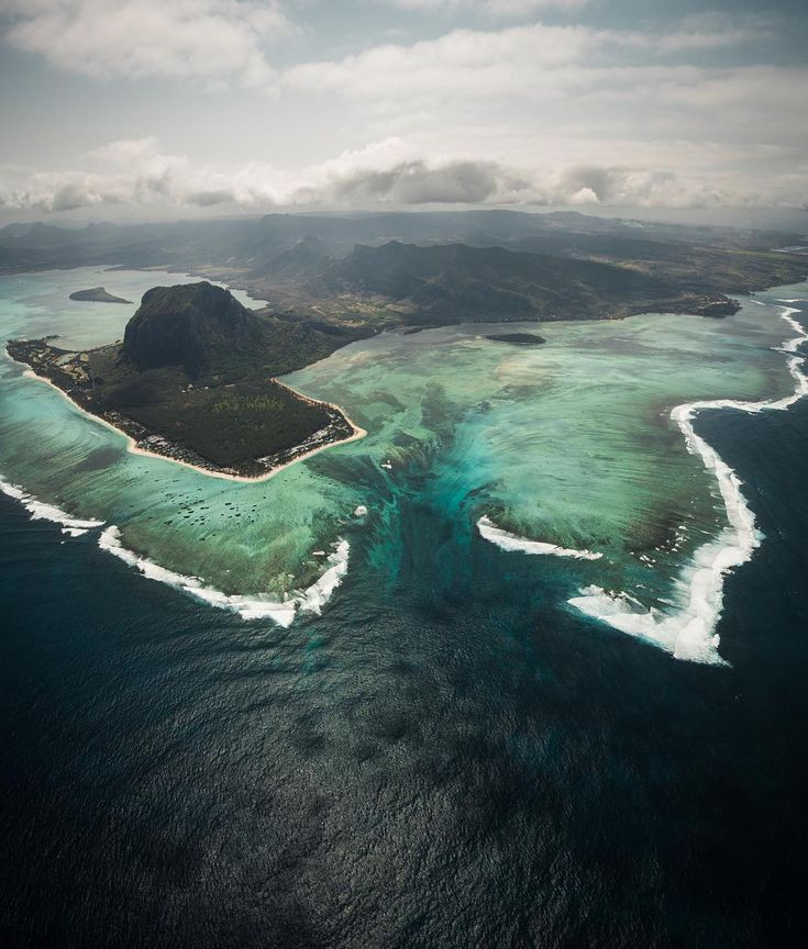 underwater waterfall illusion, Mauritius   The cause for this phenomenon is sand and silt moving down an underwater cliff. The island is located on a giant plateau, most of which is underwater. There is a huge drop-off where the waterfall effect occurs. Because waves constantly bring sand and weathering and erosion keep making sand and silt, is not very probable that this illusion will stop for a long time, if it stop at all.