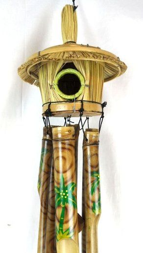 Tropical Wind Chime.  Hand carved and painted birdhouse wind chime, wood and bamboo.  http://www.farmersmarketonline.com/windchimes.htm