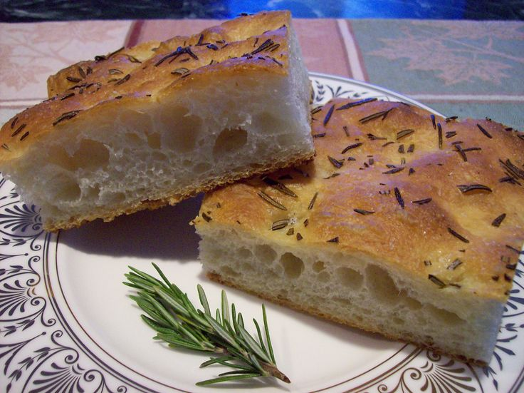 Rosemary Focaccia | Bread cetera - Poolish  320 g Heartland Mill Organic All-Purpose Flour 340 g Water 1/4 tsp. Instant Yeast Final Dough  565 g of the above Poolish 340 g Heartland Mill Organic All-Purpose Flour 170 g Water 15 g Salt 1 1/2 tsp. Instant Yeast 85 g Olive Oil Fresh, coarsely chopped Rosemary and Olive Oil, as needed Kosher Salt, to taste