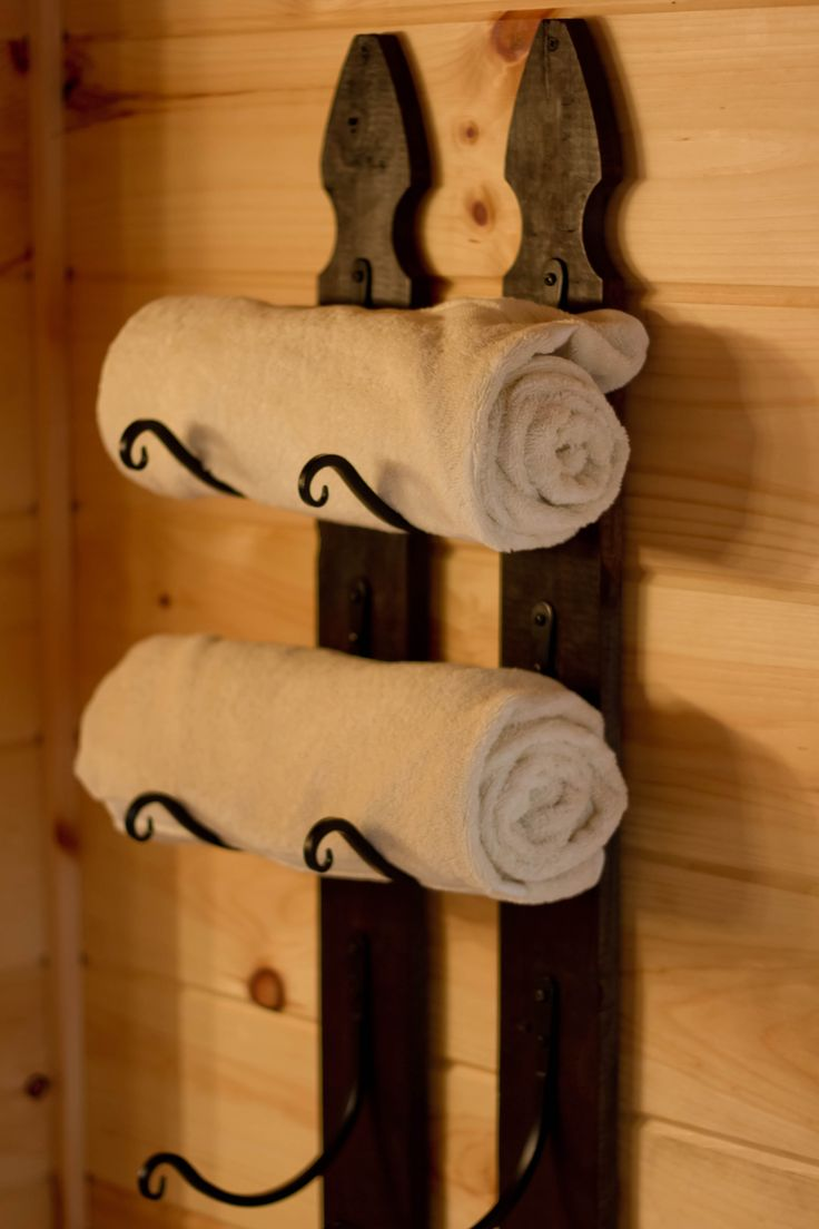 Towel rack made from picket fence and outdoor plant hangers
