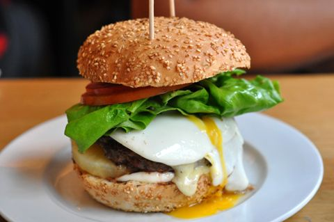 Kiwi burger from Gourmet Burger Kitchen. Beef patty, fried egg, cheese, beetroot and pineapple.
