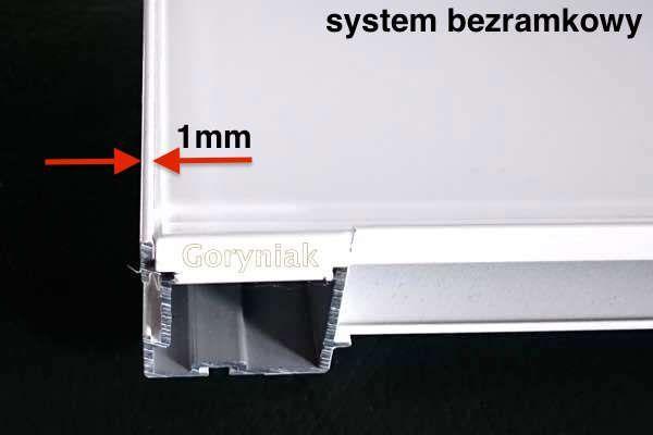 Nowoczesny bezramowy system drzwi przesuwanych - widoczna jest krawędź 1mm po obwodzie skrzydła http://www.goryniak.pl/aktualnosci.html
