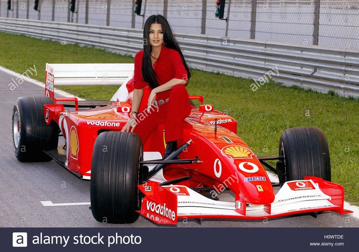 Via Reuters: Miss India 2001, Celina Jaitley, poses with a Ferrari Formula One car at Sepang circuit near Kuala Lumpur January 28, 2003. Jaitley, who is in Malaysia for a three-day visit, is the Formula One ambassador for promotion of the 2003 Petronas Malaysian Grand Prix, which will be held from March 21 to 23. REUTERS/Zainal Abd Halim ZH/RCS #CelinaJaitly #Stunning #Bollywood