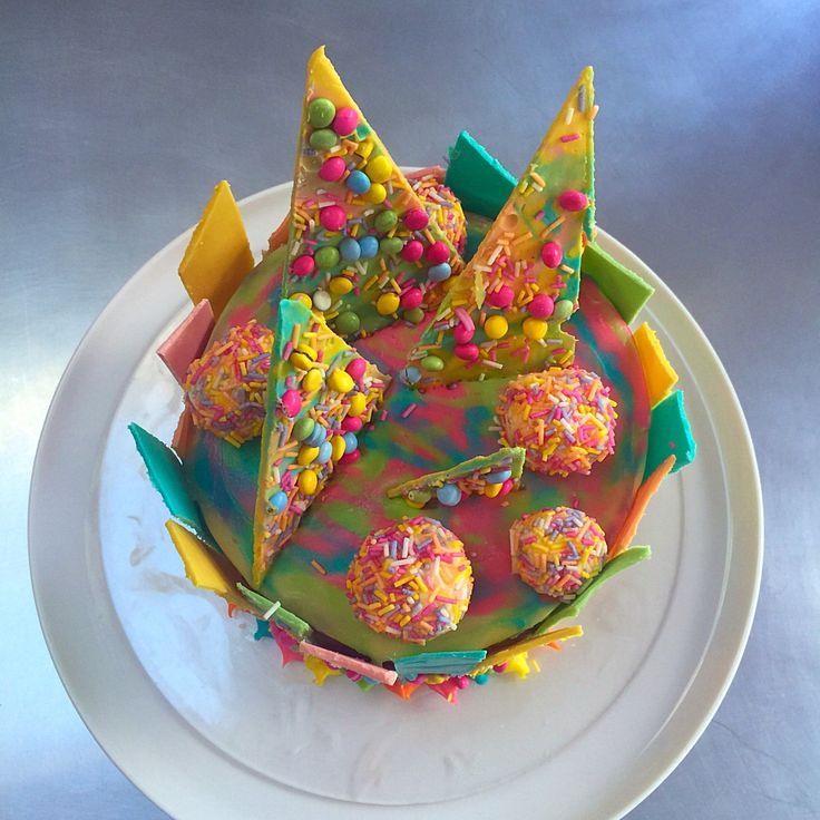 White chocolate shard cake with ganache balls and marbled ganache topping