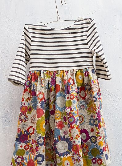 Love the mix and match of stripes and flowers in this girls' dress!
