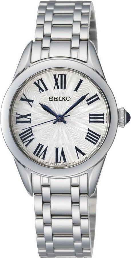 Seiko Horloge type SRZ383P1. Kaliber 7N01. Een klassiek ogend horloge. Voorzien van een zilverkleurige band en een witte wijzerplaat met Romeinse cijfers. Het horloge weegt 62 gram, heeft Hardlex glas en is 50 meter waterdicht. Voorzien van een mooie Cabochon knop. Dit horloge heeft géén datum-aanduiding. Een elegant en niet te opvallend horloge.