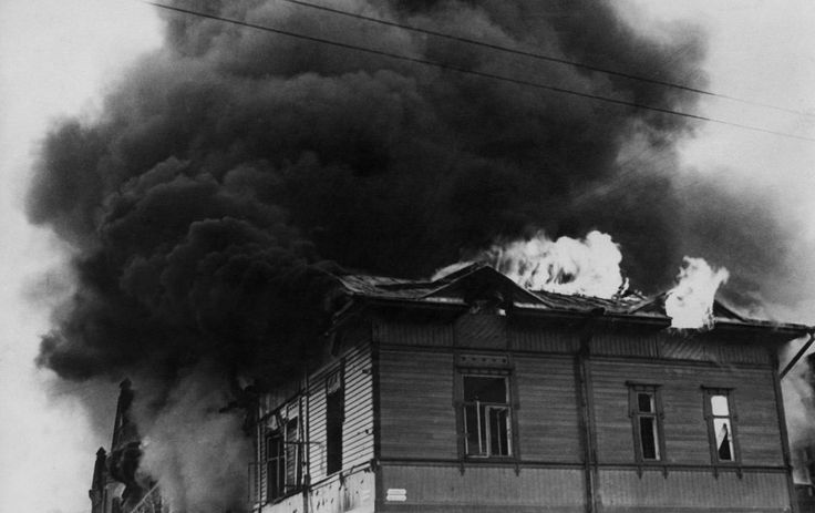 A house burns furiously after being hit by a Soviet bomb during a Russian air raid on Turku, a port city in the southwest of Finland, on December 27, 1939.