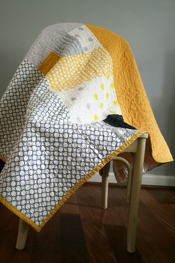 This handmade quilt measures 58x60 and made with 100% cotton fabric and organic cotton batting. Yellow and grey color combination and elephant and dot