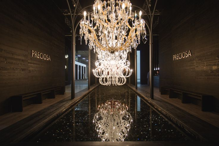 Take a minute and reflect on the timeless heritage of crystal. Two iconic Maria Theresa chandeliers and their two modern interpretations by renowned designer Rony Plesl complement each other beautifully in hall 15, stands F25+F27. #euroluce #euroluce2015 #salonedelmobile #milandesignweek2015 #preciosalighting #design #crystal #chandelier #milan