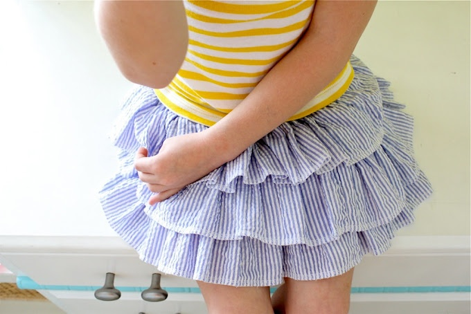 Little girls ruffle skirt tutorial.  Made in seersucker... Sweet and fresh for summer!