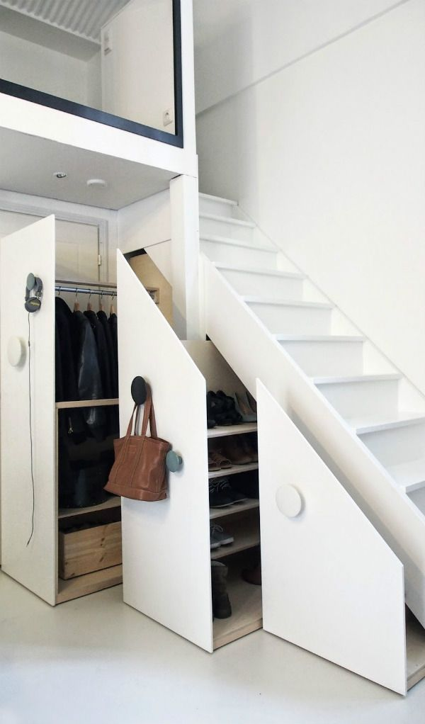 Pull out storage units under the stairs