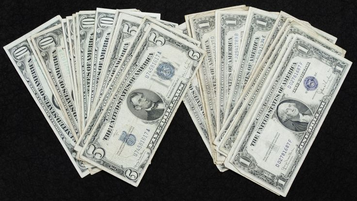 Lot 1: US Currency Assortment; Thirty-seven notes including (16) $1 silver certificates, (2) $5 silver certificates, (5) $5 federal reserve notes and (14) $10 federal reserve notes; $191 face value