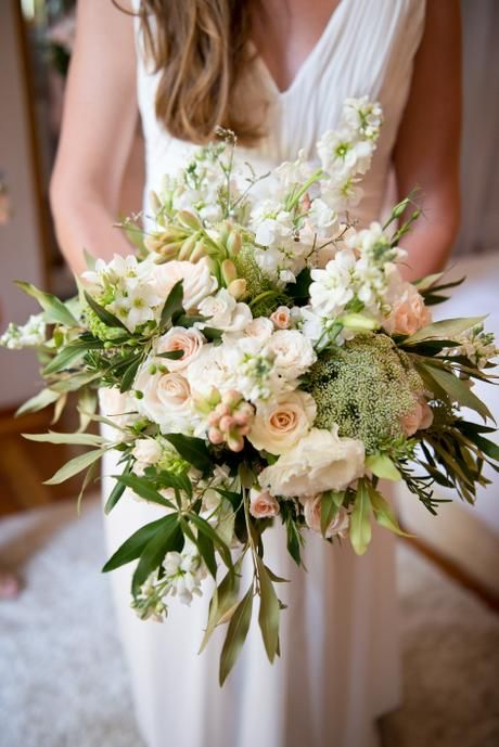 Rustic cream, blush and peach wedding. Olive and herb greenery with rose, stocks, dahlias, spray roses and tuber roses in loose, organic bridal bouquet. Flowers by www.botanica-flowers.co.za