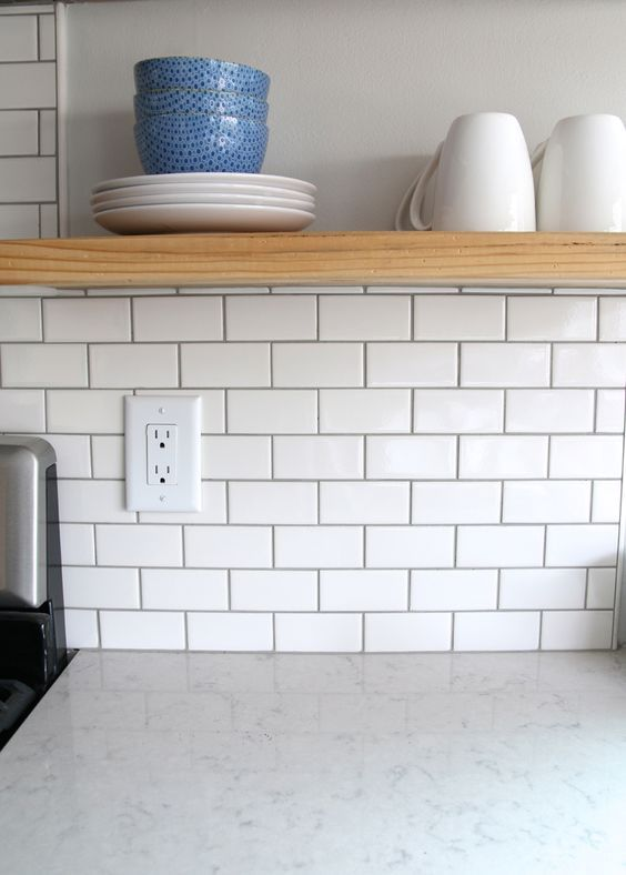 """For the backsplash I went classic with a simple 2″ x 4″ subway tile. I used American Olean White Mosaic Subway Wall tiles with """"Pewter"""" grout also available through Lowe's here."""