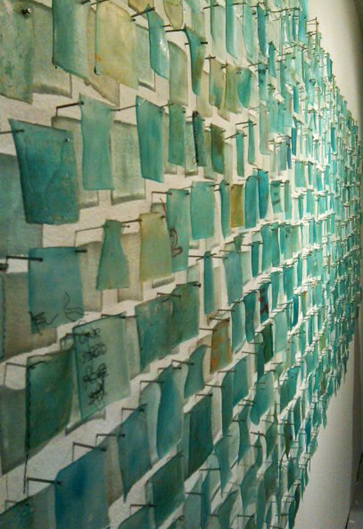 Fine art installation translucent fragments that have words stitched on them pinned to gallery wall. Mixed media sculpture printmaking, San Francisco.