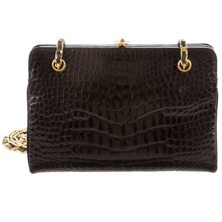 Chanel Rare Black Alligator Leather Gold Chain Flap Evening Cross Shoulder Bag   From a collection of rare vintage shoulder bags at https://www.1stdibs.com/fashion/handbags-purses-bags/shoulder-bags/