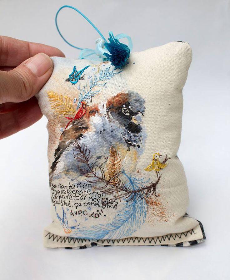 Little sparrow cushion. Acrylics with hand embroidery. Feature Edith Piaf lyrics.