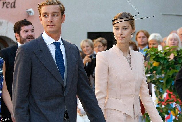 Top table guests: Pierre Casiraghi, the nephew of Prince Albert of Monaco and his girlfriend Beatrice Borromeo walk hand in hand to the chur...