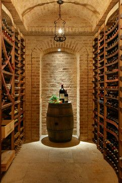 Wine Cellars in Stone - mediterranean - wine cellar - new york - Ancient Surfaces (lighting and right hand wall)