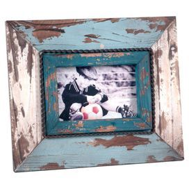 "Showcasing a distressed finish with rope-inspired trim, this weathered picture frame is a charming way to display your most cherished family memories.  Product: Picture frameConstruction Material: WoodColor: Distressed blue and whiteFeatures: Holds (1) 4"" x 6"" imageDimensions: 10"" H x 11.75"" W x 1"" D"