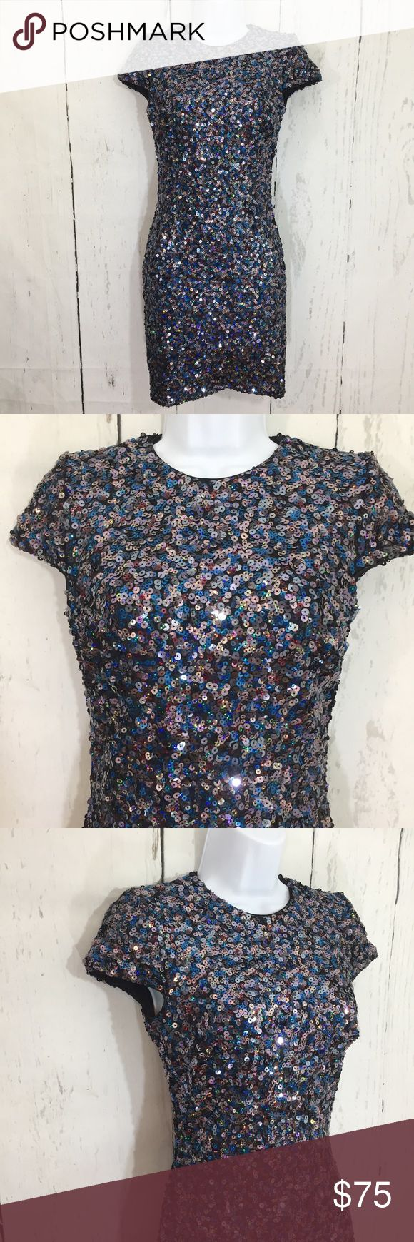 Dress the Population Taylor City Lights Dress This curve-conscious minidress comes alive with the sparkling depth of multicolored sequins. Small - bust 30, waist 24, hips 29, length 32.5, sleeve 5 Back zip closure. Jewel neck. Short sleeves. Lined. 90% polyester, 10% Lycra® spandex. Dry clean. By Dress the Population; made in the USA Dress the Population Dresses Mini