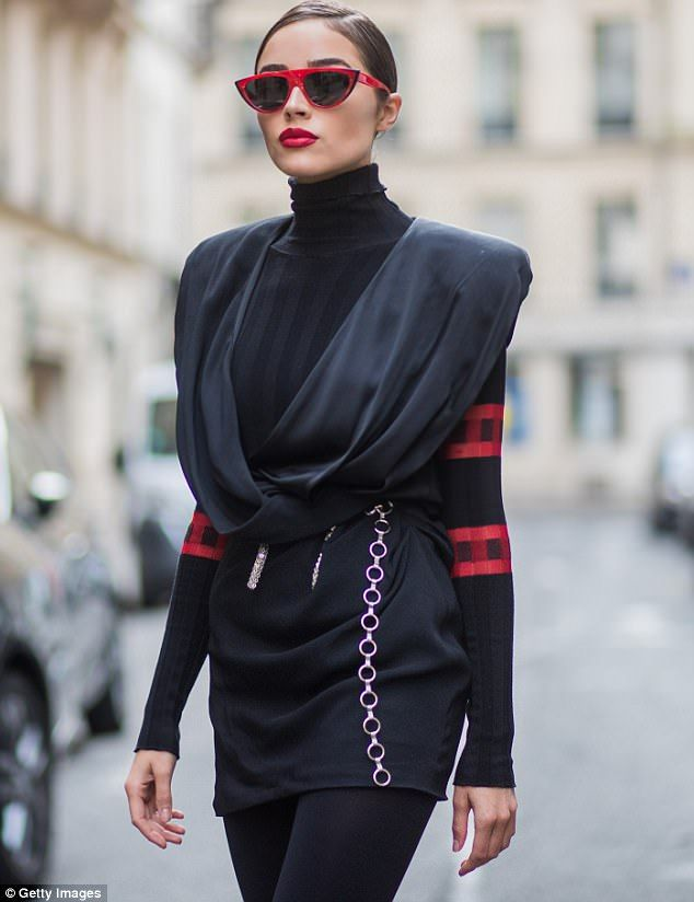 Olivia Culpo rocks knee high boots and massive shoulder pads for retro-yet-futuristic look on the streets of Paris - sunglass: Miss J