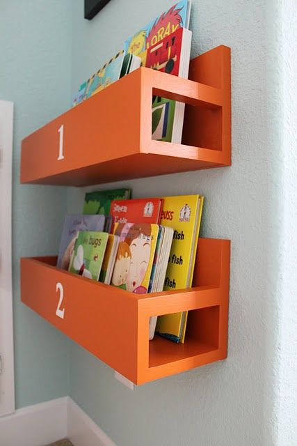 Perfect for a kid's room (decorate shelves however you want)! Maybe put next to bed for easy clean up after nighttime reading? Could do this with superhero symbols, or princess colors, etc. Great for saving room vs. the traditional book shelf.