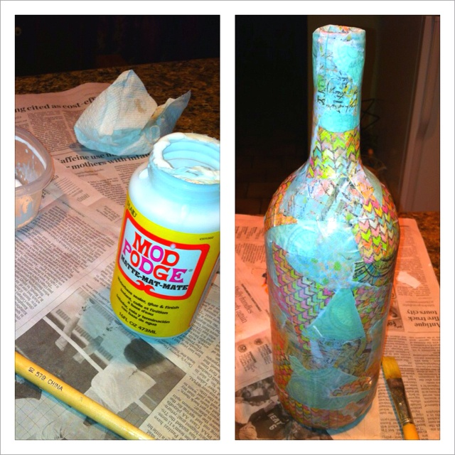 Mod podge scrapbook paper empty wine bottle wow for What to make with empty wine bottles