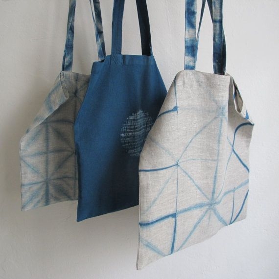 Squares and triangles of lines in indigo. Tote in 100  by byrios, $68.00