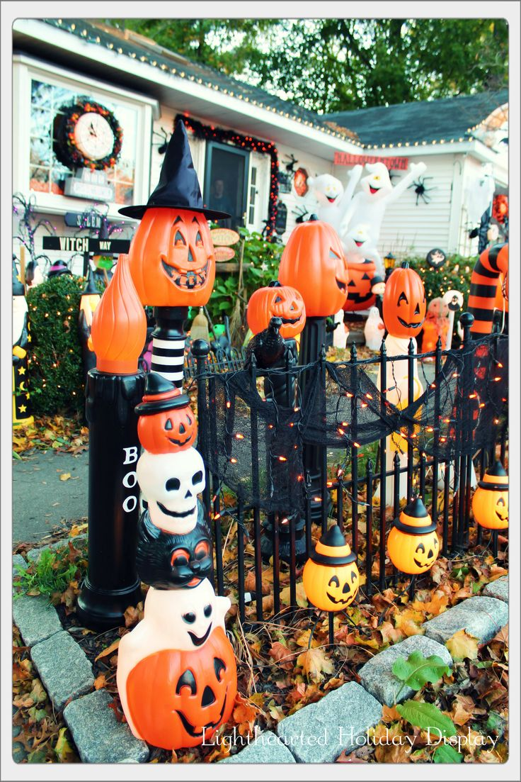 Collection of new and repurposed blowmold Halloween posts at the entrance to our yard haunt. By Angel Grant